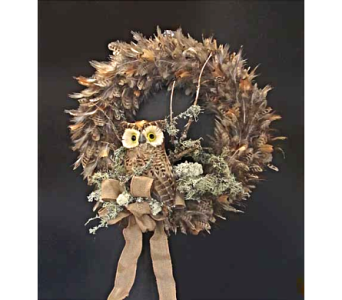 Owl sitting in a feather wreath